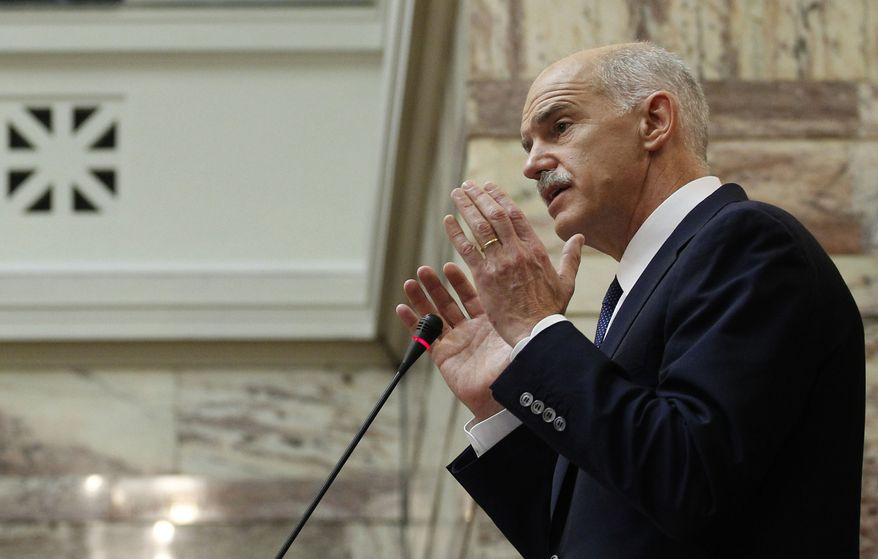 Greek Prime Minister George Papandreou addresses Socialist party members of parliament in Athens on Nov. 3, 2011. Greece's embattled prime minister says he has invited opposition conservatives to join talks on a major European debt deal, ignoring calls to hold an early general election. (Associated Press)
