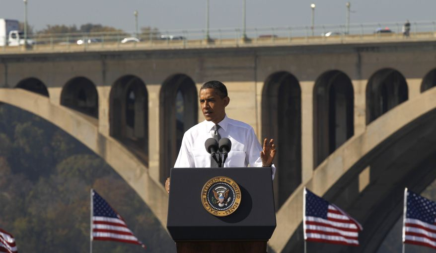 President Obama speaks in front of the Key Bridge, which spans D.C. and Arlington, Va., on Nov. 2, 2011, urging Congress to pass the infrastructure piece of the American Jobs Act. (Associated Press)