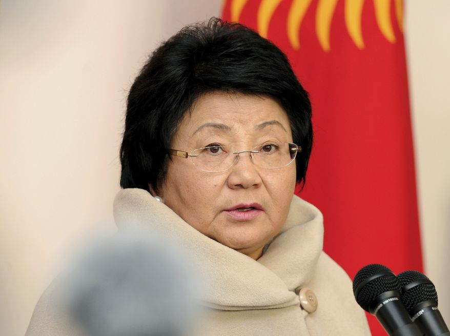 **FILE** Kyrgyz President Roza Otunbayeva speaks to the media Oct. 30, 2011, at a polling station during the presidential election in Bishkek, Kyrgyzstan. (Associated Press)