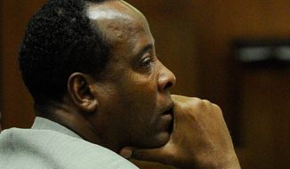 ** FILE ** Dr. Conrad Murray listens to the defense's closing arguments during his involuntary manslaughter trial in the death of singer Michael Jackson at the Los Angeles Superior Court on Thursday, Nov. 3, 2011. (Associated Press)