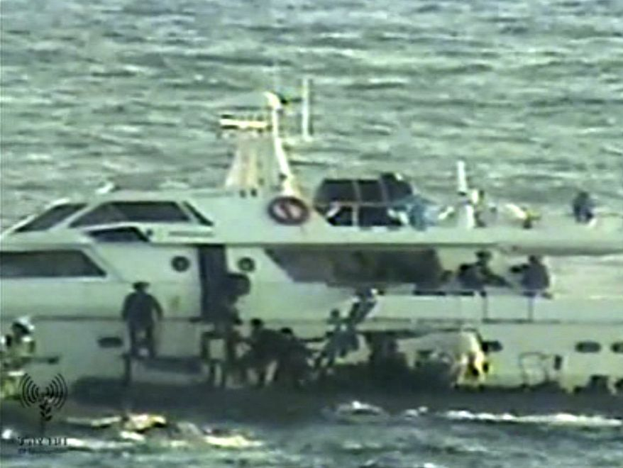 In this video image released by the Israeli Defense Ministry on Nov. 4, 2011, Israeli soldiers on several small military boats appear to board a civilian boat believed to be one of two protest boats trying to violate Israel's blockade of the Gaza Strip. (Associated Press/Israeli Army)