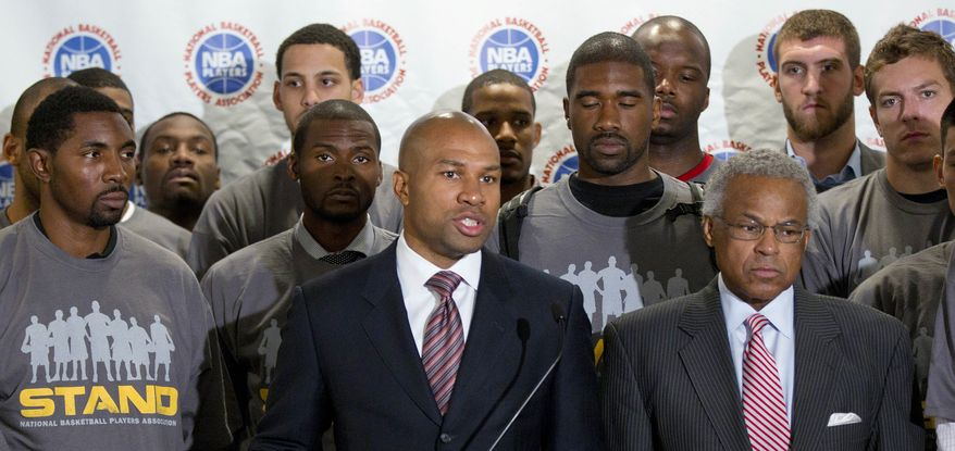 In this Sept. 15, 2011 photo, Los Angeles Lakers' Derek Fisher, center, president of the NBA players union, is joined by union executive director Billy Hunter, right, and NBA players during a news conference in Las Vegas. With progress stalled since talks broke off over the revenue split, the union's executive committee is to meet in New York. Union President Fisher and executive director Hunter sent separate letters to members this week denying reports about a rift. (AP Photo/Julie Jacobson, File)