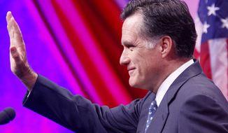 Former Massachusetts Gov. Mitt Romney waves after speaking at the Defending the American Dream Summit in Washington on Nov. 4, 2011. (Associated Press)