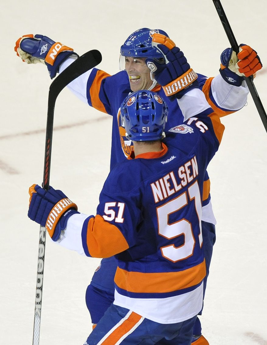 New York Islanders' Brian Rolston celebrates his goal with teammate Frans Nielsen during the second period against the Washington Capitals on Saturday, Nov. 5, 2011, in Uniondale, N.Y. The Isles won 5-3. (AP Photo/Kathy Kmonicek)
