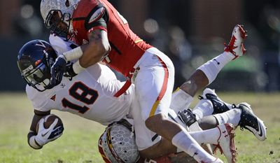 Virginia wide receiver Kris Burd recorded nine catches for 112 yards against Maryland on Saturday. Those nine receptions gave him 142 for his collegiate career, third most in Cavs' history. (AP Photo/Patrick Semansky)