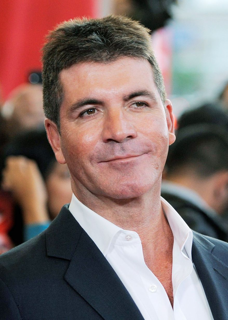 """FILE - In this Sept. 14, 2011 file photo, Simon Cowell, executive producer and judge on """"The X Factor,"""" poses at a world premiere screening event for the singing competition series in Los Angeles. Cowell said Tuesday he predicts one of the female contestants he's mentoring on """"The X Factor"""" will win the competition. (AP Photo/Chris Pizzello, file)"""