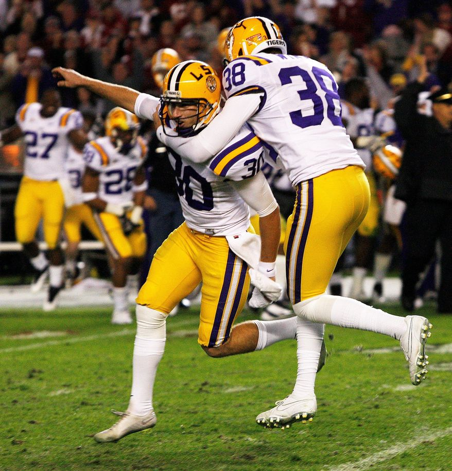 LSU's Drew Alleman (left) celebrates with Brad Wing after kicking the game-winning field goal in a 9-6 overtime victory over Alabama on Saturday night. (Associated Press)