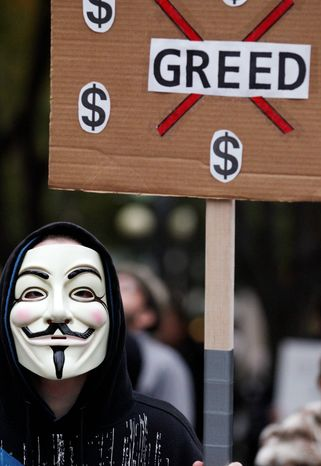 Whether they know it or not, some of the demonstrators decrying a variety of society's ills are sporting the stylized masks loosely modeled on 17th-century terrorist Guy Fawkes. The Catholic insurrectionist was executed four centuries ago for trying to blow up the British Parliament. (Associated Press)