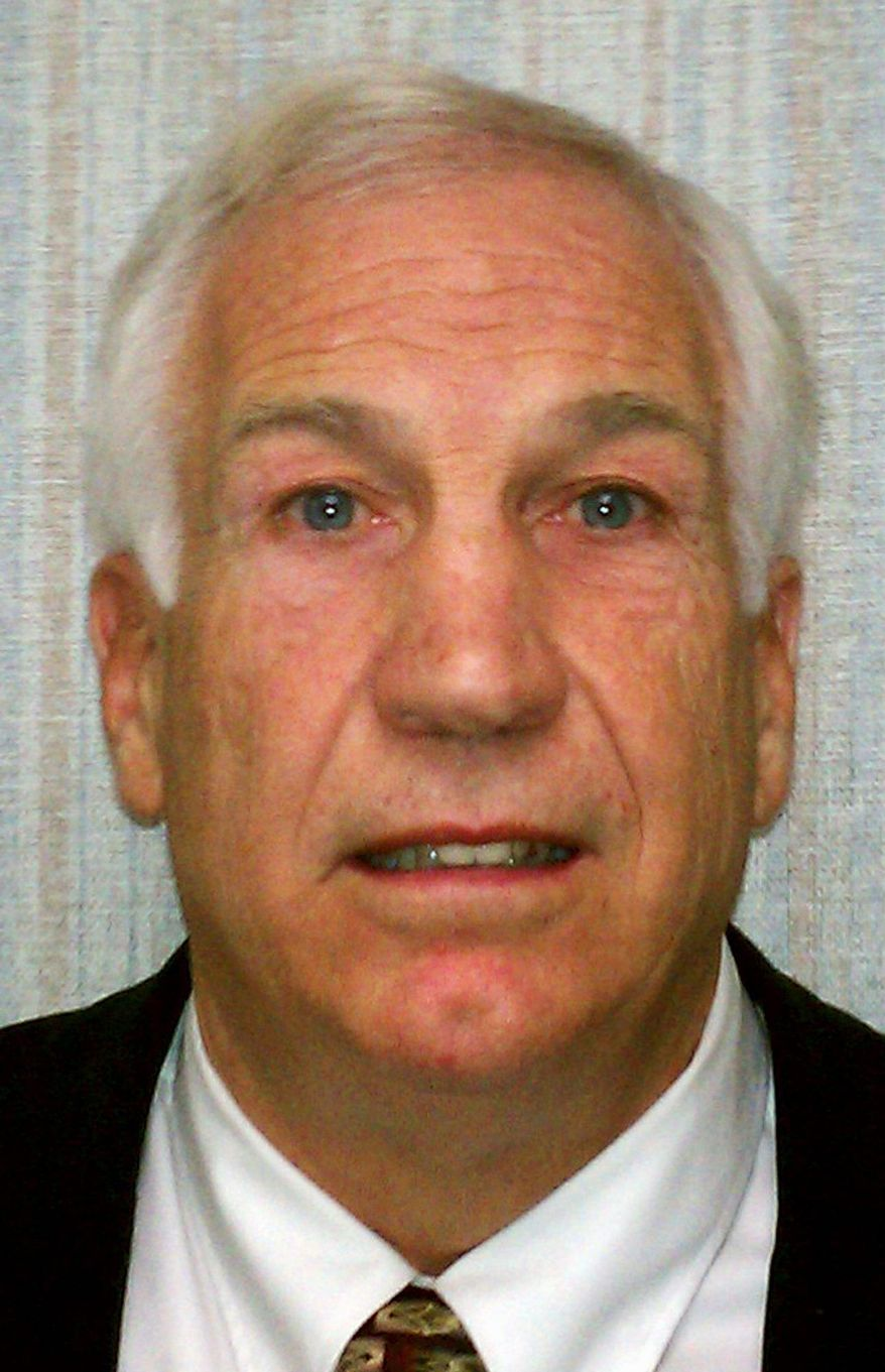 Former Penn State defensive coordinator Jerry Sandusky was charged with sexually assaulting eight boys over 15 years. (Associated Press)