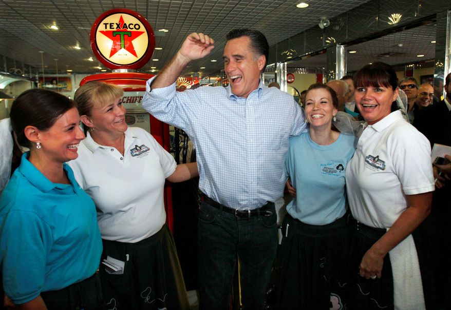 Former Massachusetts Gov. Mitt Romney, a Republican presidential candidate, laughs with servers at Mary Ann's Diner during a campaign stop in Derry, N.H., in June. The eatery, decorated in '50s and '60s decor, is a must-visit campaign stop for presidential candidates campaigning in New Hampshire. (Associated Press)
