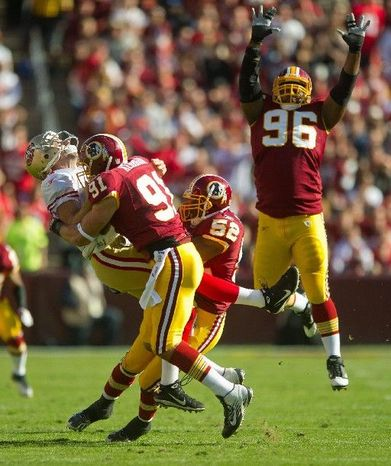 Washington Redskins LB Ryan Kerrigan and LB Rocky McIntosh (52) sack San Francisco 49ers QB Alex Smith for a loss of 7 yards during the first quarter at FedEx Field in Landover, Md. Sunday, November 6, 2011. (Rod Lamkey Jr. / The Washington Times)