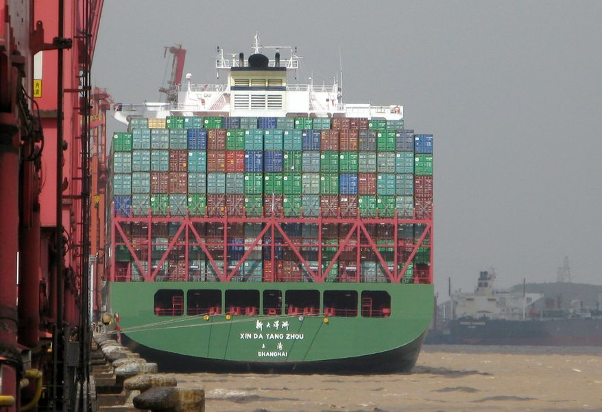 A container ship visits the port in Ningbo, China, which has been in business for 1,200 years and now handles more than 100 million tons of cargo a year. It is one of the few in the world to reach that mark. (Orange County [Calif.] Register)