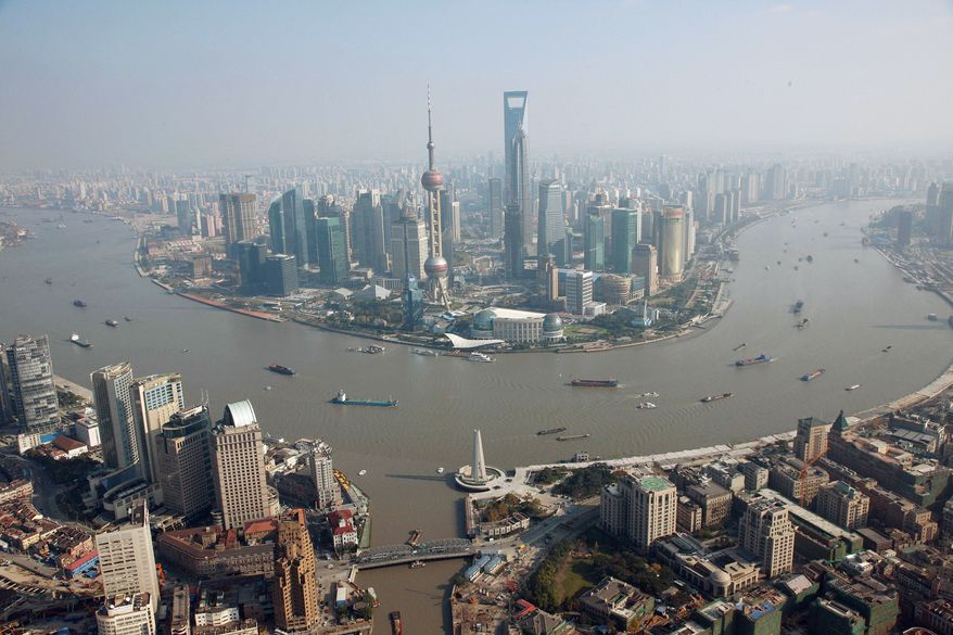 BOOMTOWN:The cities of Shanghai (above) and Ningbo are now connected by a 22.5-mile ocean-spanning bridge, spurring talk that the region will become one of the world's largest metropolises. Port cities in China are now gearing up for a new generation of high-tech export goods rather than the lower-end consumer goods of the past decade. (Shanghai Pacific Institute for International Strategy via Associated Aress)
