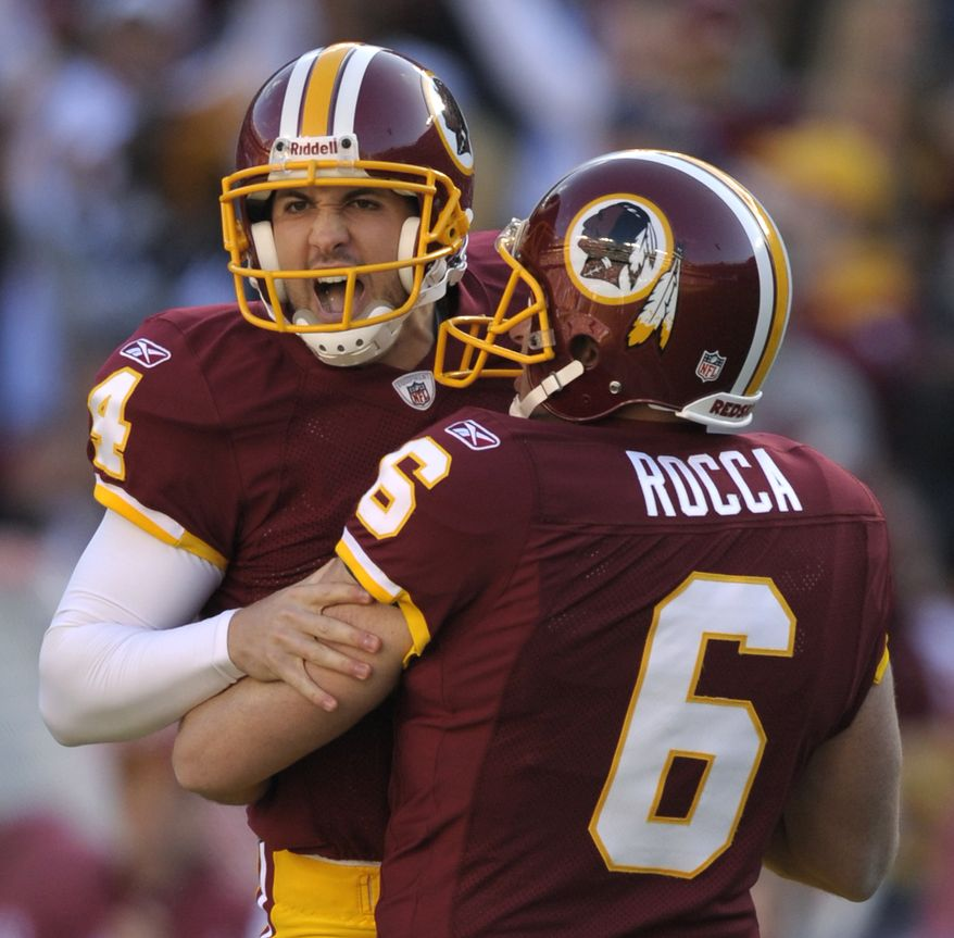 Washington Redskins kicker Graham Gano reacts with teammate Sav Rocca after making a 59-yard field goal in the first half against the San Francisco 49ers in Landover, Md., Sunday, Nov. 6, 2011. (AP Photo/Cliff Owen)