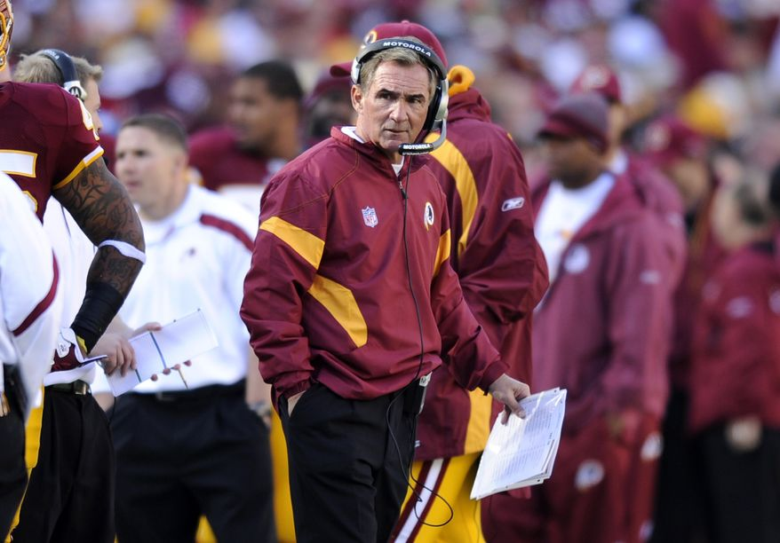 Washington Redskins head coach Mike Shanahan looks on from the sideline during the football game against the San Francisco 49ers in Landover, Md., Sunday, Nov. 6, 2011. Washington lost 19-11. (AP Photo/Nick Wass)