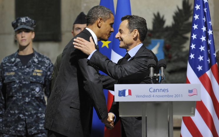 President Obama and French President Nicolas Sarkozy hug as they attend a French-U.S. alliance ceremony at the Cannes City Hall on Friday, Nov. 4, 2011, after the end of the second day of the G-20 summit. (AP Photo/Philippe Wojazer, Pool)