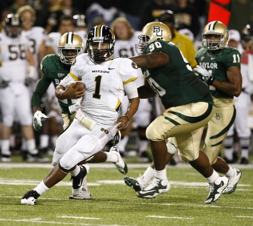 Missouri quarterback James Franklin (1) runs past Baylor's Nicolas Jean-Baptiste (right) during an NCAA football game on Saturday, Nov. 5, 2011, in Waco, Texas. Baylor won 42-39. (AP Photo/The Waco Tribune-Herald, Jose Yau)