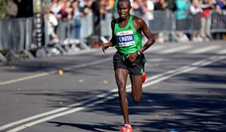 Geoffrey Mutai of Kenya runs through Central Park in New York on his way to winning the ING New York City Marathon on Sunday, Nov. 6, 2011. (AP Photo/Craig Ruttle)
