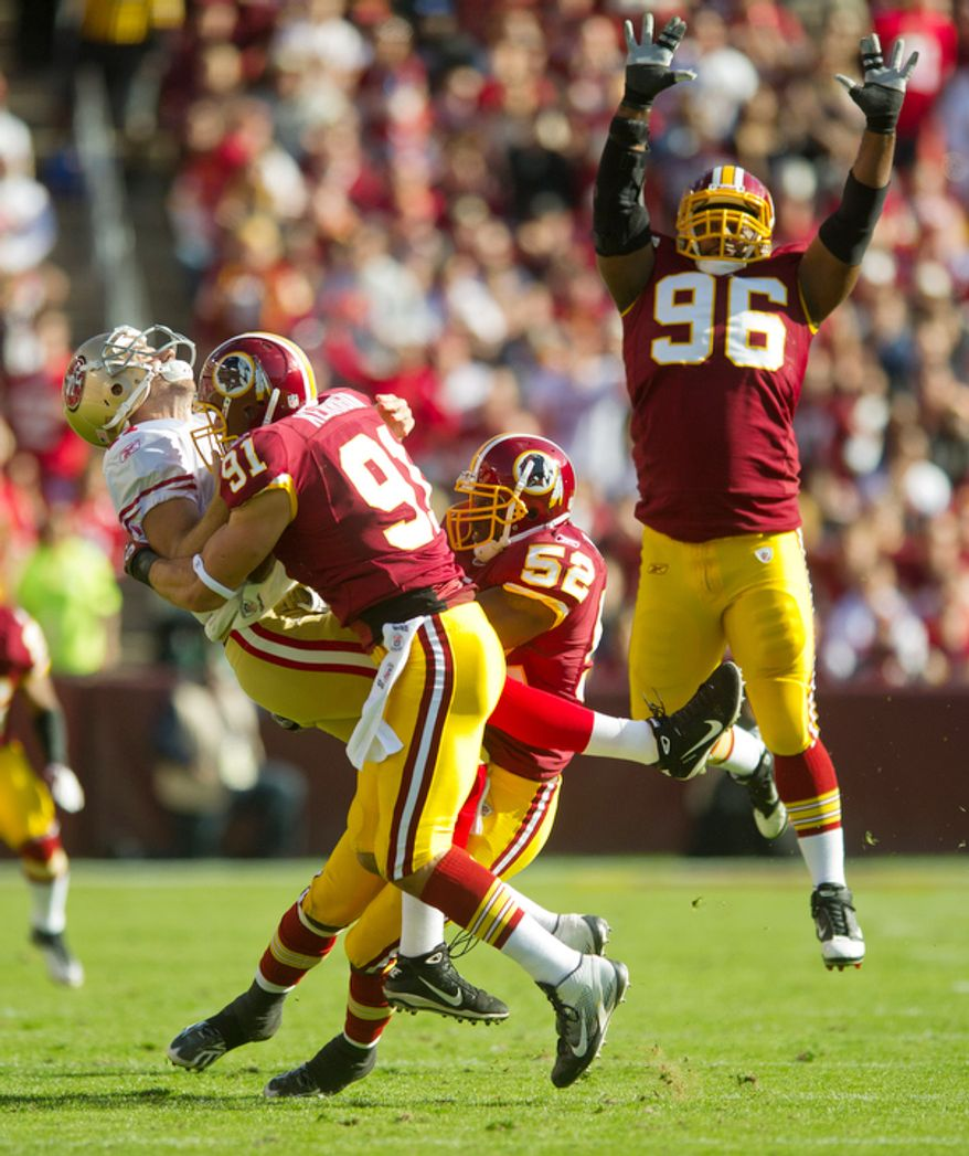 Washington Redskins Ryan Kerrigan and Rocky McIntosh (52) sack San Francisco 49ers Alex Smith for a loss of 7 yards during the first quarter. (Rod Lamkey Jr. / The Washington Times)