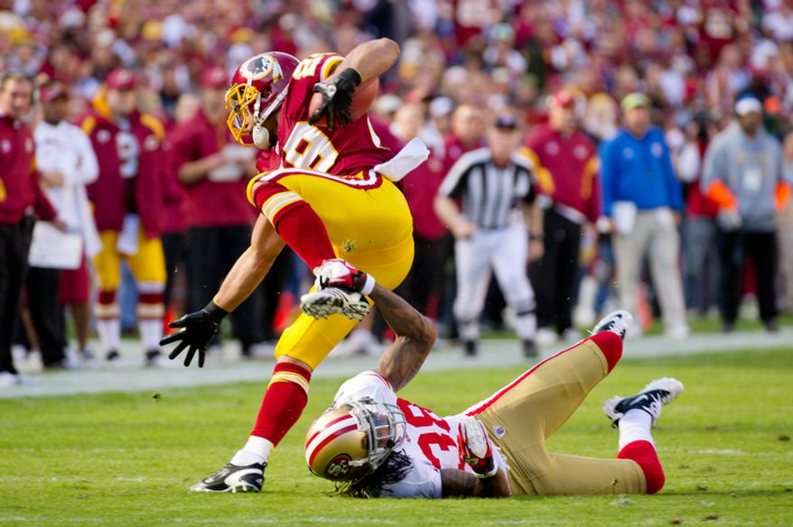 Washington Redskins Roy Helu (29) picks up two yards over San Francisco 49ers Dashon Goldson (38) during the first quarter. (Andrew Harnik / The Washington Times)