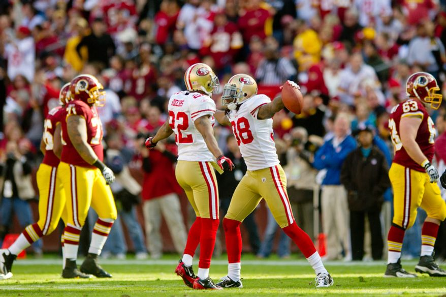 The Washington Redskins offense leaves the field after an interception by San Francisco 49ers Dashon Goldson during the first quarter. (Rod Lamkey Jr. / The Washington Times)