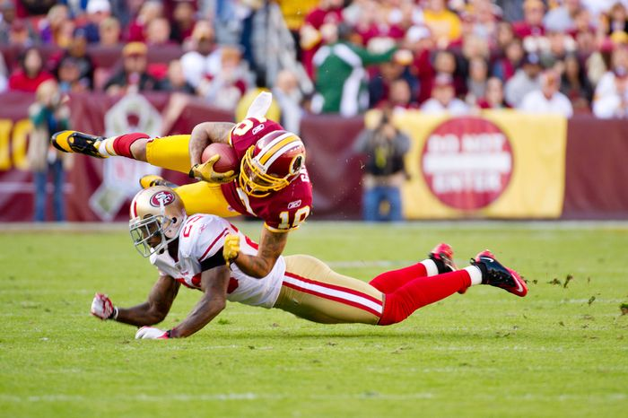 Washington Redskins Jabar Gaffney (10) picks up 10 yards but it is called back for a personal foul during play against the San Francisco 49ers in the second quarter. (Andrew Harnik / The Washington Times)