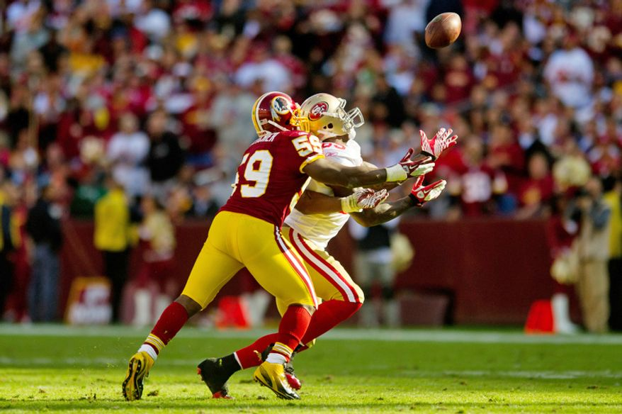 Washington Redskins London Fletcher (59) breaks up a pass intended for San Francisco 49ers Vernon Davis (85) during the second quarter. (Rod Lamkey Jr. / The Washington Times)