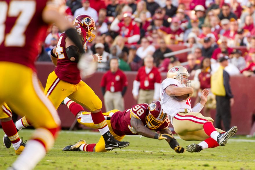 Washington Redskins Brian Orakpo (98) hits San Francisco 49ers Alex Smith (11) after a run for three yards during the third quarter. (Andrew Harnik / The Washington Times)