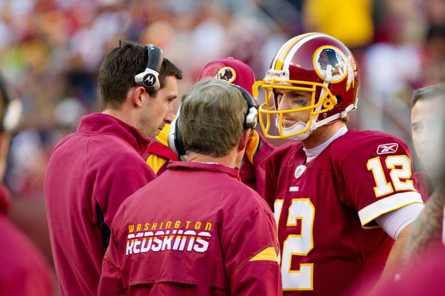 Washington Redskins quarterback John Beck talks with offensive coordinator Kyle Shanahan and head coach Mike Shanahan during the game against the San Francisco 49ers. A source confirmed to The Washington Times that Beck split first-team reps with Rex Grossman in preparation for Sunday's game against the Miami Dolphins. (Andrew Harnik / The Washington Times)