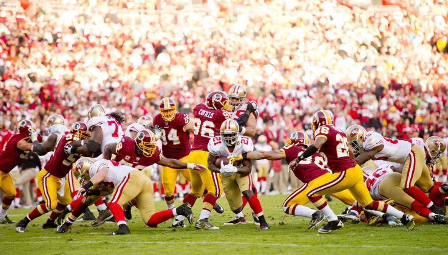 The Washington Redskins allow San Francisco 49ers Frank Gore (21) to pick up 6 yards during the fourth quarter. (Andrew Harnik / The Washington Times)