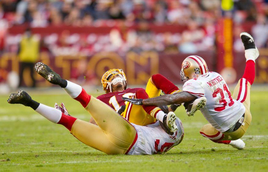 Washington Redskins Terrence Austin (18) fumbles to the San Francisco 49ers during the fourth quarter. (Rod Lamkey Jr. / The Washington Times)