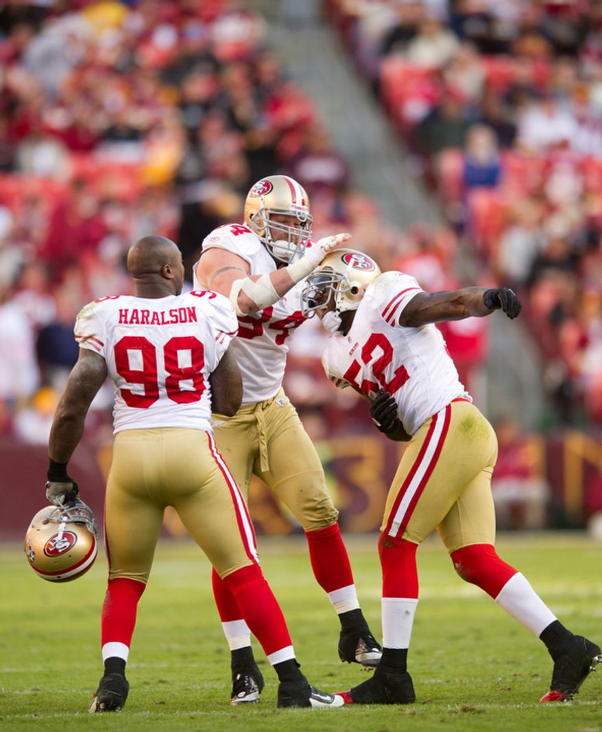 San Francisco 49ers Patrick Willis (52) celebrates with teammates after causing Washington Redskins Terrence Austin to fumble during the fourth quarter. (Rod Lamkey Jr. / The Washington Times)
