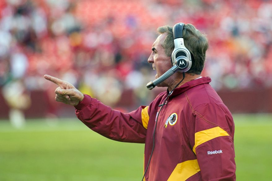 Washington Redskins head coach Mike Shanahan motions to his players from the sidelines against the San Francisco 49ers during the fourth quarter. (Rod Lamkey Jr. / The Washington Times)