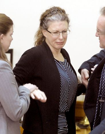 Tracey Richter is consoled at Webster County District Court in Fort Dodge, Iowa, on Monday after a jury convicted her of murder in the 2001 death of her 20-year-old neighbor. Richter faces life in prison at her Dec. 5 sentencing. (Associated Press)