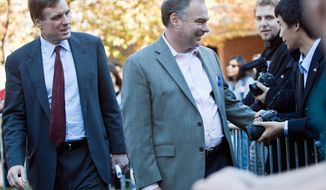 ** FILE ** Former Virginia Gov. Tim Kaine (center) and his fellow Democrat, Sen. Mark R. Warner, attend a get-out-the-vote rally at George Mason University in Fairfax on Monday, Nov. 7, 2011. (The Washington Times)