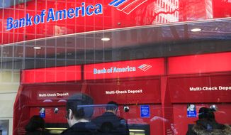 ** FILE ** In this Jan. 31, 2011 photo, Bank of America customers use ATM machines in New York. (AP Photo/Mark Lennihan)