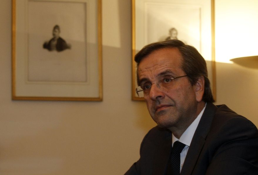 Greek opposition leader Antonis Samaras attends a meeting with Greek President Karolos Papoulias and Prime Minister George Papandreou at the Presidential Palace in Athens on Sunday, Nov. 6, 2011. (AP Photo/Kostas Tsironis)