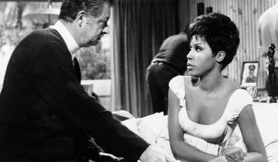 """Producer Hal Kanter, who died Sunday at age 92, talks to actress Diahann Carroll on the set of the situation comedy """"Julia,"""" which Kanter created. (Associated Press)"""