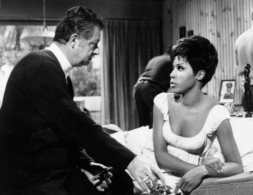 "Producer Hal Kanter, who died Sunday at age 92, talks to actress Diahann Carroll on the set of the situation comedy ""Julia,"" which Kanter created. (Associated Press)"