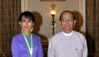 ** FILE ** Myanmar pro-democracy leader Aung San Suu Kyi (left) meets with President Thein Sein at the presidential office in the capital of Naypyitaw in 2010. (Associated Press)