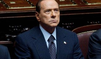 Mr. Berlusconi attends a voting session at the lower chamber on Tuesday. Mr. Berlusconi won a much-watched vote Tuesday, but the result laid bare his lack of support in parliament as financial pressure from the eurozone debt crisis pummeled Italy. (Associated Press)
