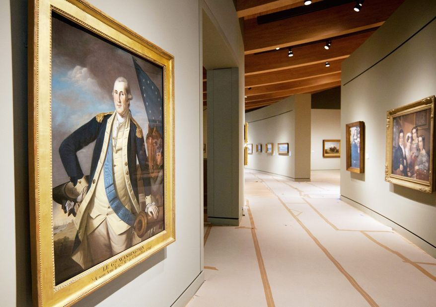 A portrait of George Washington, painted by Charles Willson Peale between 1780 and 1782, is displayed among other works from the Colonial period at the Crystal Bridges Museum of American Art in Bentonville, Ark. The museum, set to open Friday, will display about 440 works of art. Sections of the museum sit amid a tree-lined ravine in Bentonville, Ark. The museum is a 10-minute walk through the woods from Bentonville's downtown square, on 120 acres owned by the Walton family. (Associated Press)