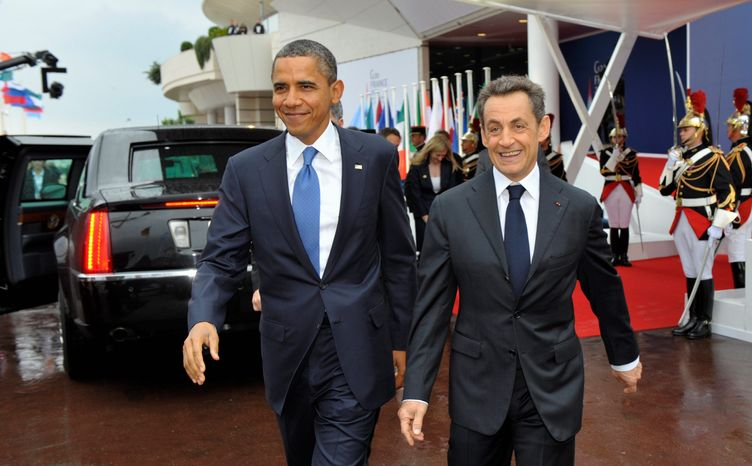 """An inadvertent """"open mic"""" night caught French President Nicolas Sarkozy and President Obama disparaging their Israeli counterpart. (Associated Press)"""