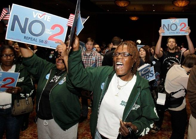 Charlene Petties, a custodian in the Columbus, Ohio, school system, supports the repeal of Senate Bill 5 during a rally on Tuesday in Columbus. The measure's repeal by voters was a stinging loss for Gov. John Kasich. (Associated Press)