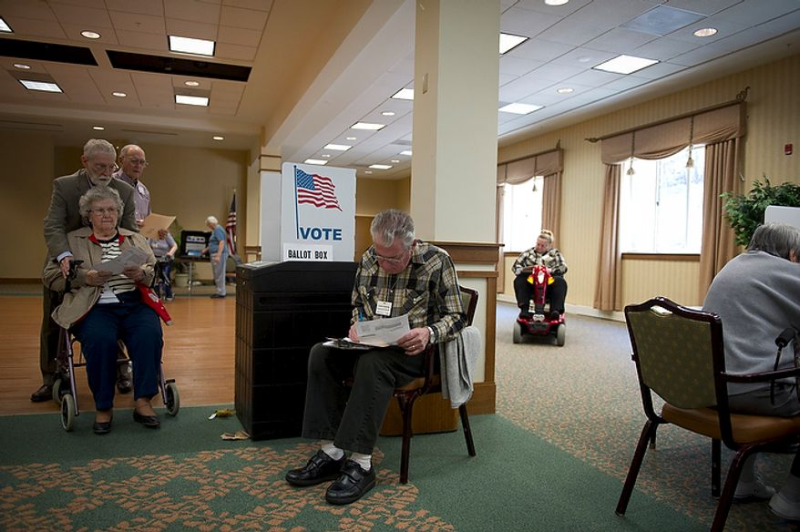 Clyde Humphrey (center) looks over his ballot as elderly voters spend time at the polls at the Greenspring retirement community in Springfield, Va., Tuesday, Nov. 8, 2011. (Rod Lamkey Jr./The Washington Times)