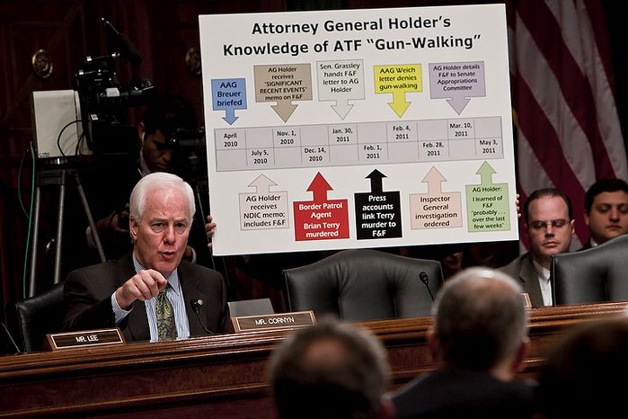 Sen. John Cornyn, Texas Republican, grills U.S. Attorney General Eric H. Holder Jr. (in foreground) on the Bureau of Alcohol, Tobacco, Firearms and Explosives' controversial gun-smuggling tactics during a Senate Judiciary Committee hearing in Washington on Tuesday, Nov. 8, 2011. (T.J. Kirkpatrick/The Washington Times)