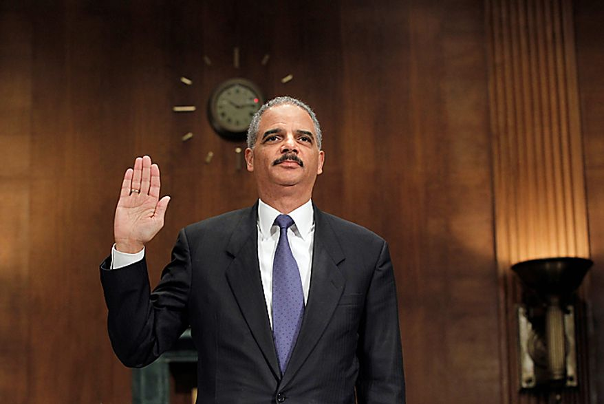 """Attorney General Eric H. Holder Jr. is sworn in on Capitol Hill in Washington on Tuesday, Nov. 8, 2011, before testifying before a Senate Judiciary Committee hearing on the arms-trafficking investigation of """"Operation Fast and Furious."""" (AP Photo/J. Scott Applewhite)"""