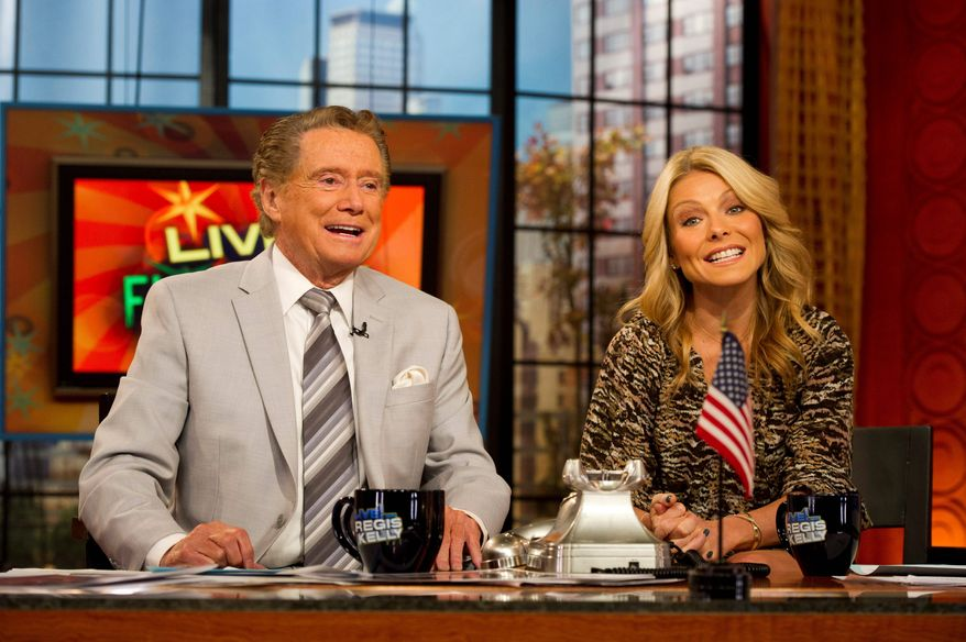 """After ruling morning television for 28 years, Regis Philbin (left), the co-host who made performance art of TV gab is exiting """"Live! With Regis and Kelly."""" His last day is Nov. 18. (Associated Press)"""