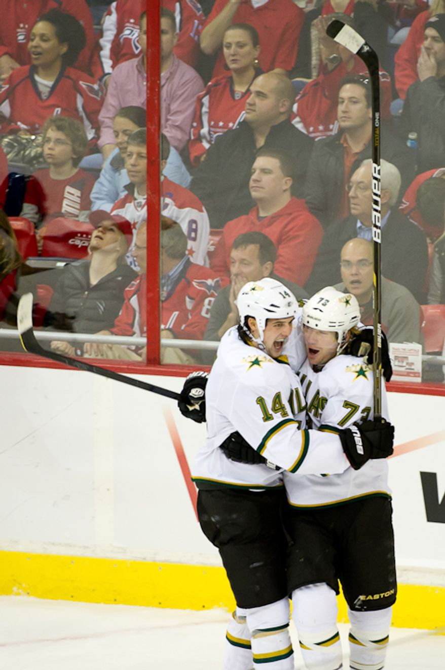 Michael Ryder (73) with the Dallas Stars celebrates his goal with teammate Jamie Benn (14) to pull them ahead 2-1 during the 1st period at the Verizon Center in Washington, DC. Tuesday, November 8, 2011. (Andrew Harnik / The Washington Times)