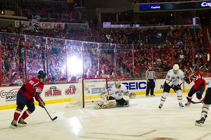 Goalie Kari Lehtonen (32) of the Dallas Stars just blocks a shot on goal during the 2nd period at the Verizon Center in Washington, DC. Tuesday, November 8, 2011. (Andrew Harnik / The Washington Times)